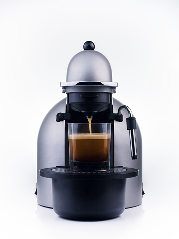 Grey coffee maker with a transparent glass and coffee inside