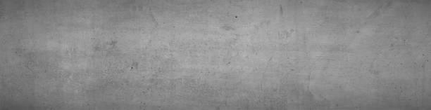 Graue Betonwand, Hintergrund Grau, 16:9 Breitbild, Hintergrund im Industrial Design, Strukturierte Textur. Betonwand Textur mit leicht dunkler Vignette – Foto