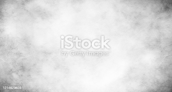 1061630554 istock photo Grey concrete wall, black and white grunge background, stone texture, exterior surface of concrete, cement, sand and stone, natural, old, floor, construction, architecture 1214629623