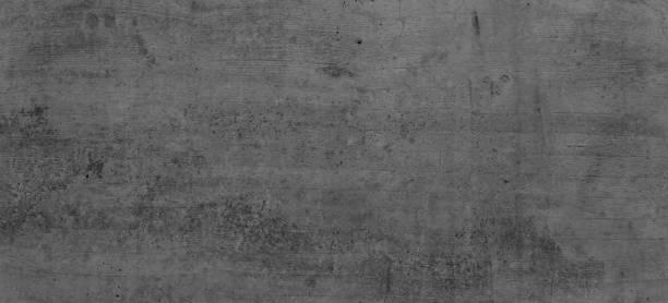 Graue Betonwand, Rustikale Wand, Dunkler Hintergrund, Dunkelgraue Wand mit Strukturen, Betonwand Struktur mit Vigentte, dunkle Ränder. 45MP. – Foto