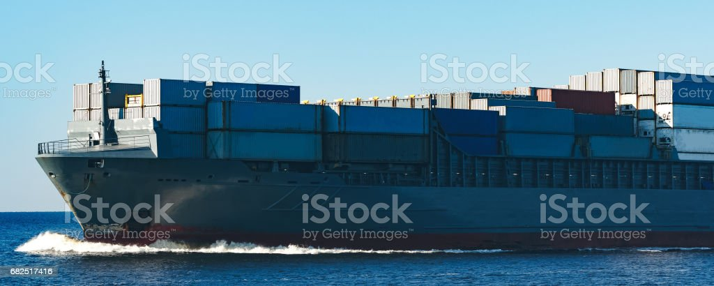 Grey container ship Lizenzfreies stock-foto