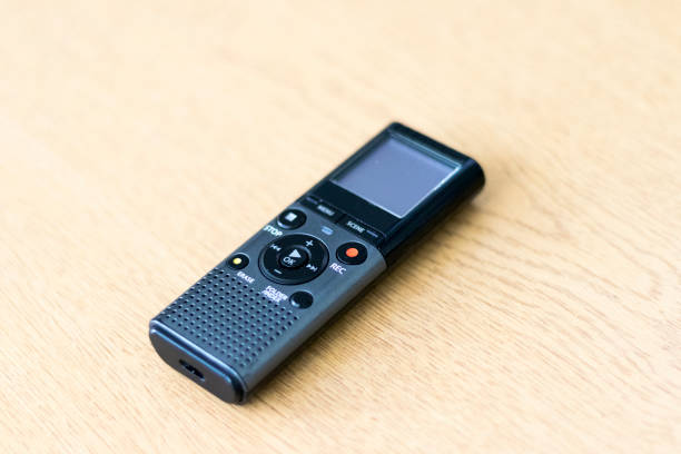 grey digital dicaphone on a table - dictaphone stock pictures, royalty-free photos & images