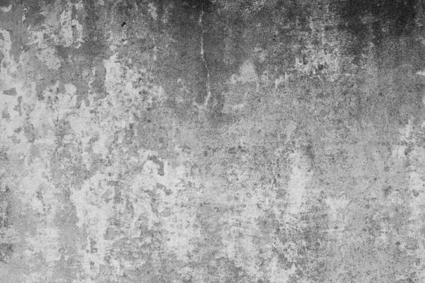 Graue, schmutzige, rissige Betonwand als Hintergrund und Textur im Industrial Design als gestalterisches Element für Kunst und Kollagen und weiterbearbeitung. Steinwand mit dunklem bis hellem Verlauf. – Foto