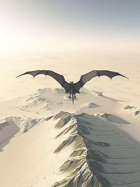 Grey Dragon Flight Over Snowy Mountains stock photo