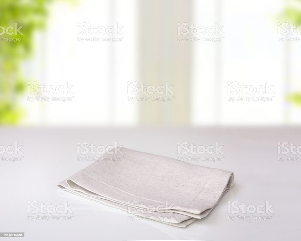 Grey folded kitchen cloth on table indoor. stock photo