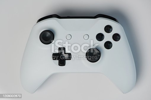 Grey game controller with black buttons macro close up view