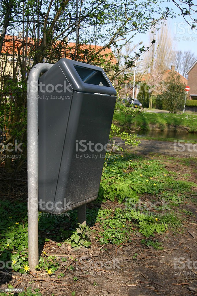 Grey garbage can royalty-free stock photo