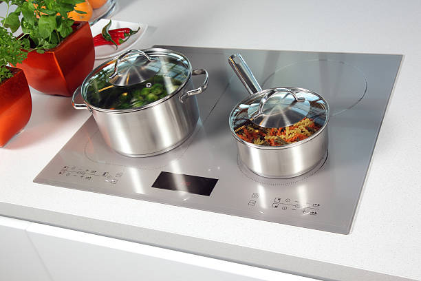 Grey glass induction hob stock photo