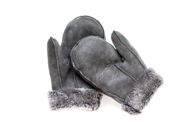 grey  gloves with natural fur. - paire de gants photos et images de collection