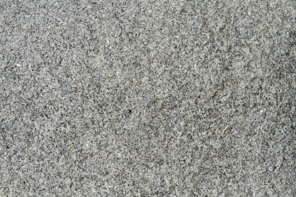 grey granite rock background - granite rock stock photos and pictures