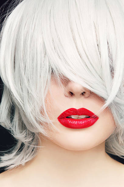 Grey hair and red lipstick - Photo