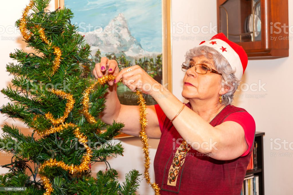Christmas In Latin America.A Grey Haired Senior Latin American Lady With A Christmas
