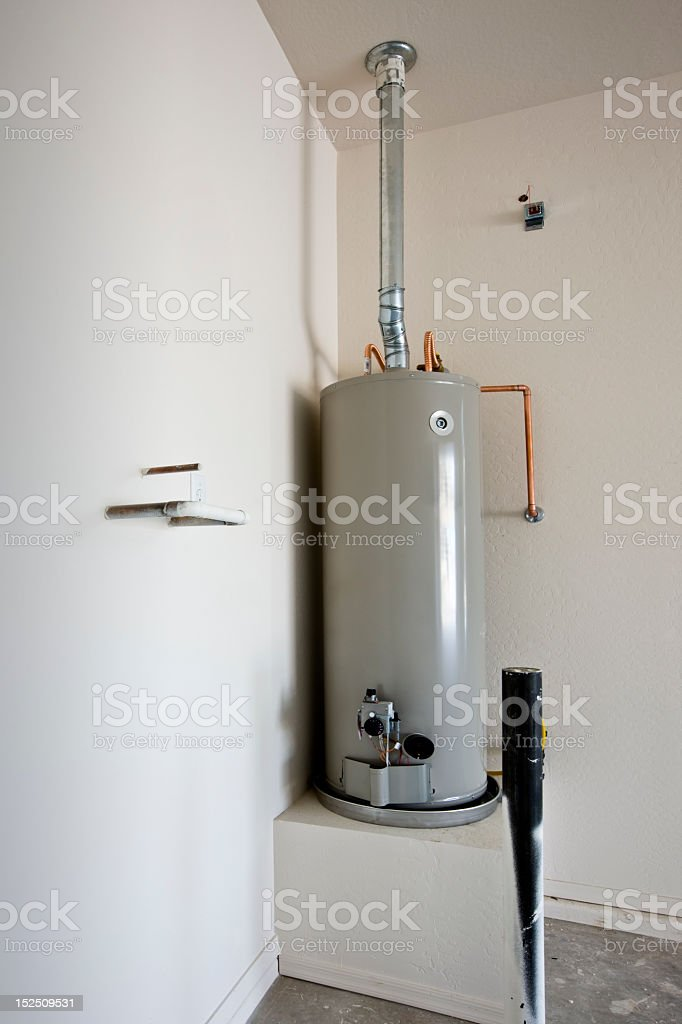 A grey hot water tank mounted on a box platform stock photo