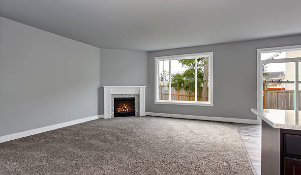Grey house interior of living room with fireplace and carpet stock photo
