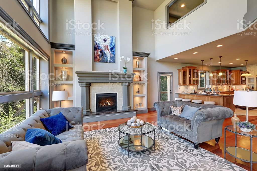 Grey interior of high vaulted ceiling family room. stock photo