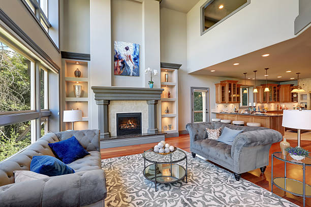 grey interior of high vaulted ceiling family room. - family room stock photos and pictures