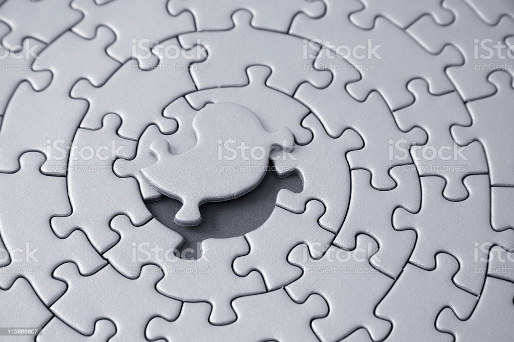 grey jigsaw with missing piece laying above the space royalty-free stock photo