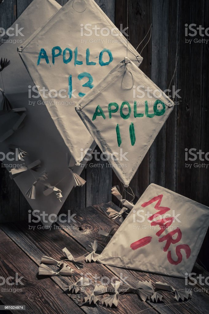 Grey kites with space missions names as space flight concept stock photo
