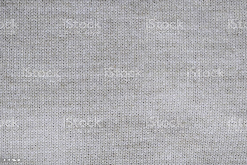 Grey knitted background. Surface wool texture. Copy space for your...