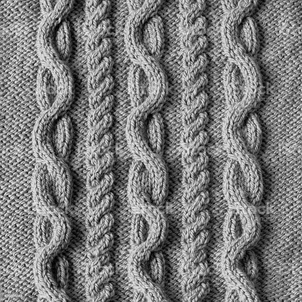 Grey knitted wool texture background alternating pattern stock photo