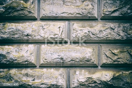Grey masonry, stonework, brickwork texture. Concrete different gray stone surface. Rock gloomy pattern background. Abstract urban dirty rough grainy stone wall