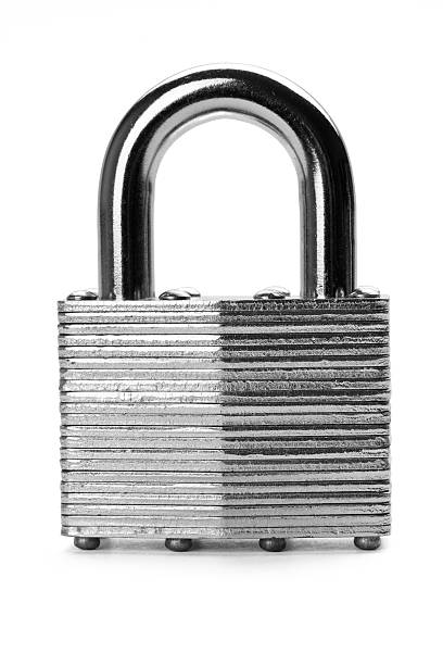 Grey, metal security lock against a white background Close up of padlock isolated on white background with soft shadow. Concept of security or guarantee. padlock stock pictures, royalty-free photos & images