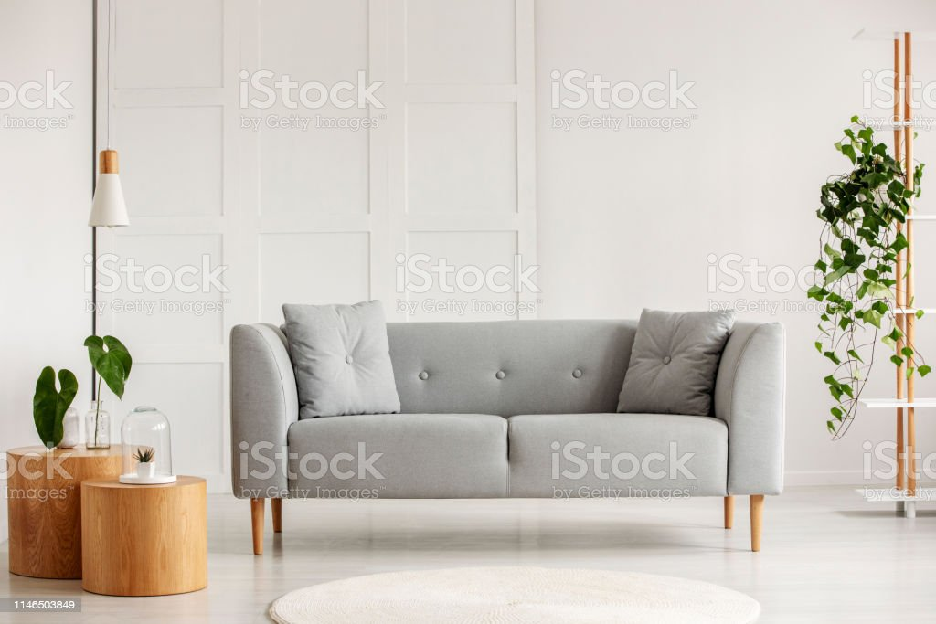 Picture of: Grey Modern Sofa In The Center Of Living Room Stock Photo Download Image Now Istock