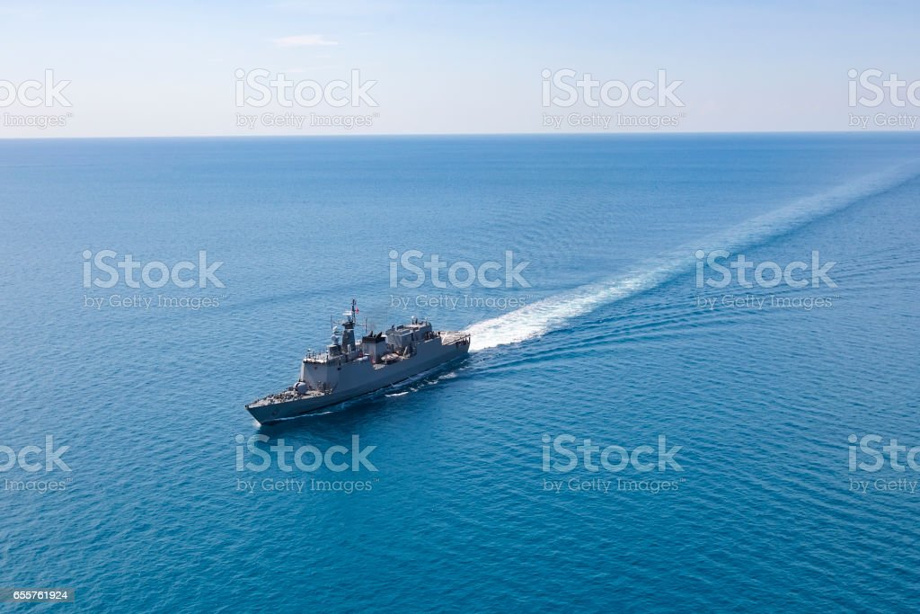 Grey modern warship, helicopter view stock photo