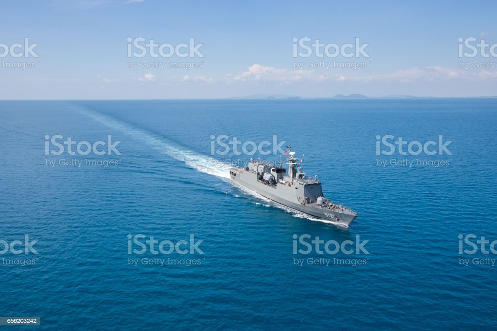 Grey modern warship helicopter view stock photo