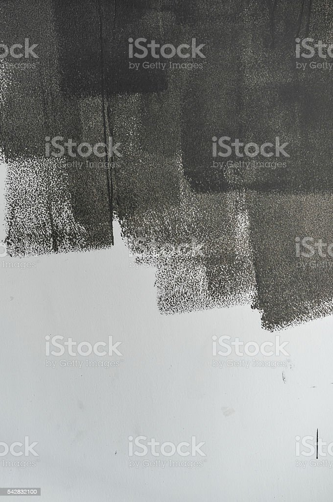 Grey paint on white wall. stock photo
