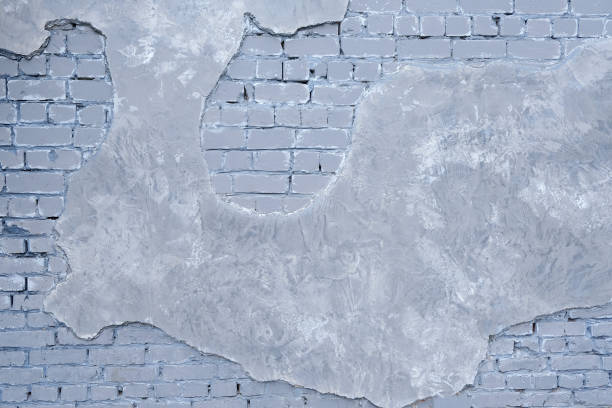 Grey Painted cracked brick wall texture Background. stock photo
