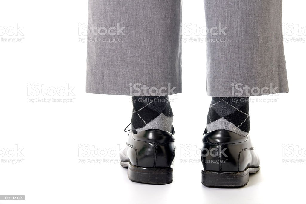Grey pants stopping above ankles stock photo