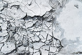 istock Grey pattern or textured background with cracked concrete. 1143688883