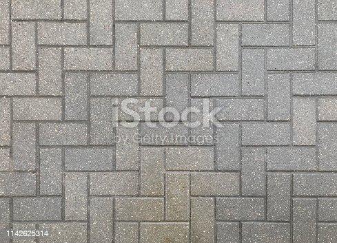 istock Grey pavement texture 1142625314