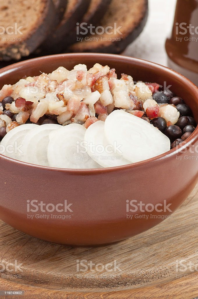 Grey peas with bacon and onion royalty-free stock photo