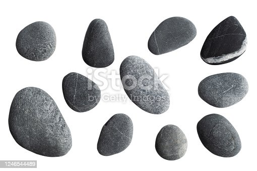 Grey pebbles isolated on white background.  Top view of sea stones