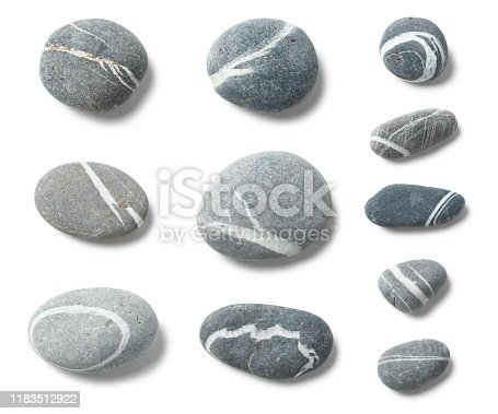 Arranged pebbles isolated on white with clipping path