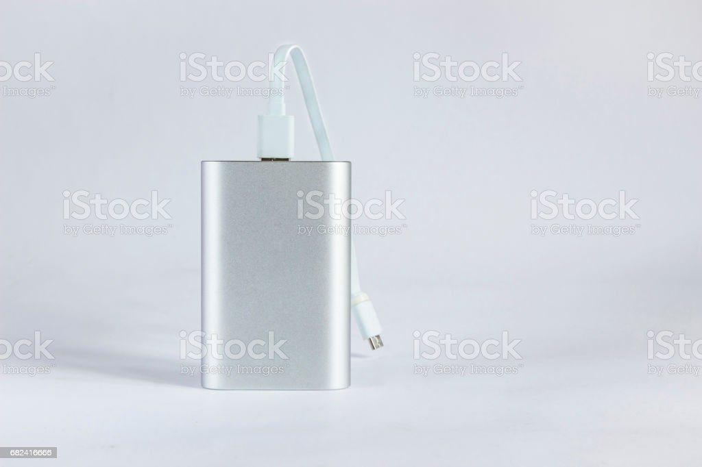 Grey portable external battery isolated on a white background royalty-free stock photo
