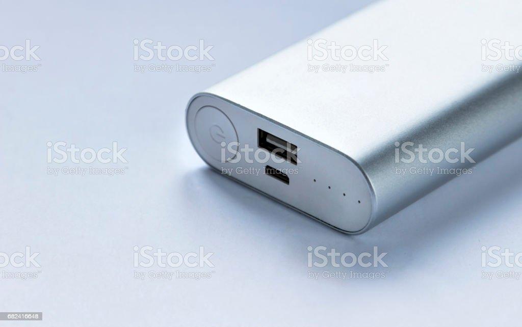 Grey portable external battery ( power bank ) . Selective focus royalty-free stock photo