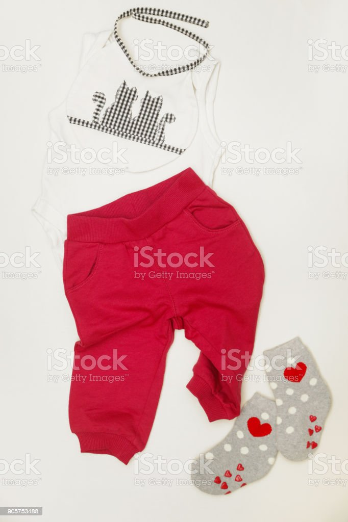 Grey & red baby outfit stock photo