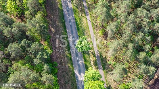 1095367134 istock photo grey road and a power line, aerial view 1151194121