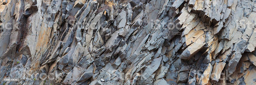 grey rock mountain panorama background - stone texture stock photo