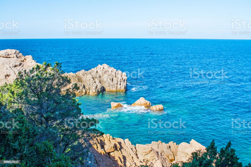Grey rocks and blue sea royalty-free stock photo