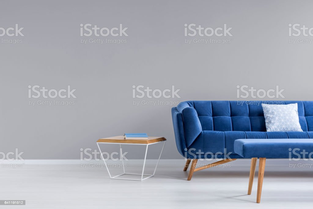 Grey room with blue couch stock photo