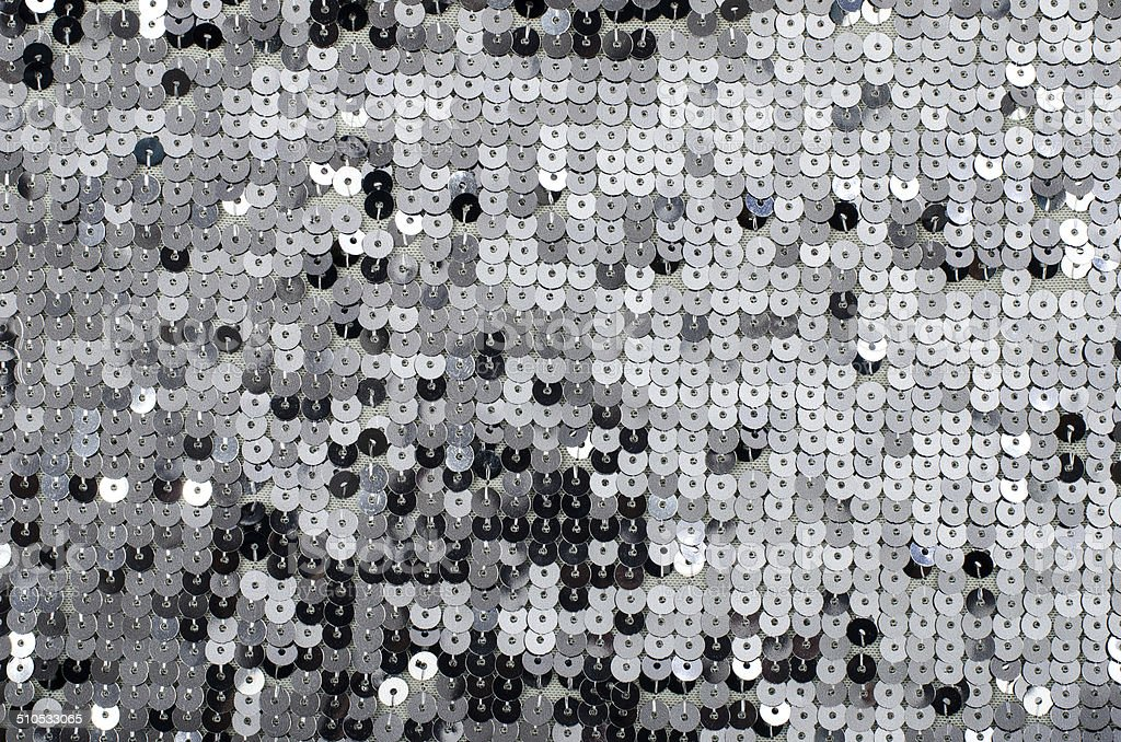 Grey sequins pattern. Sparkling sequins background. stock photo