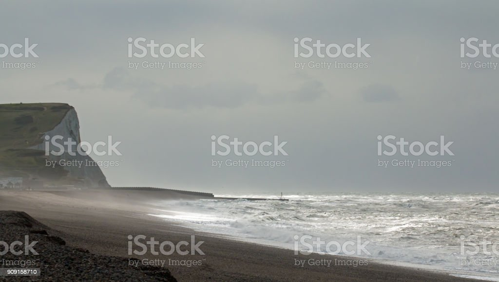 Grey Sky and Sunlight over Seaford Bay stock photo