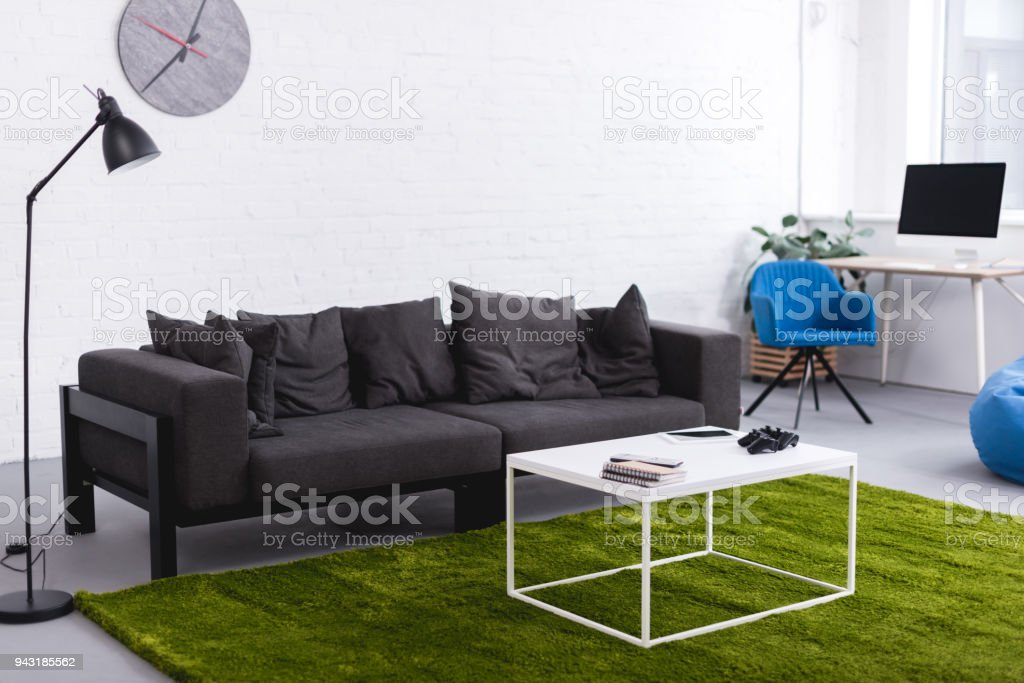 Grey Sofa And Green Carpet With Tables In Living Room Stock Photo Download Image Now Istock