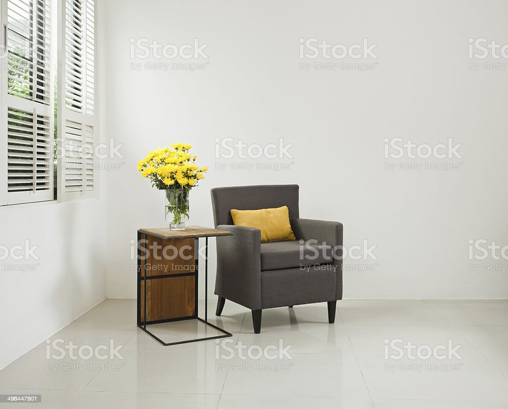 Grey sofa armchair in simple setting stock photo