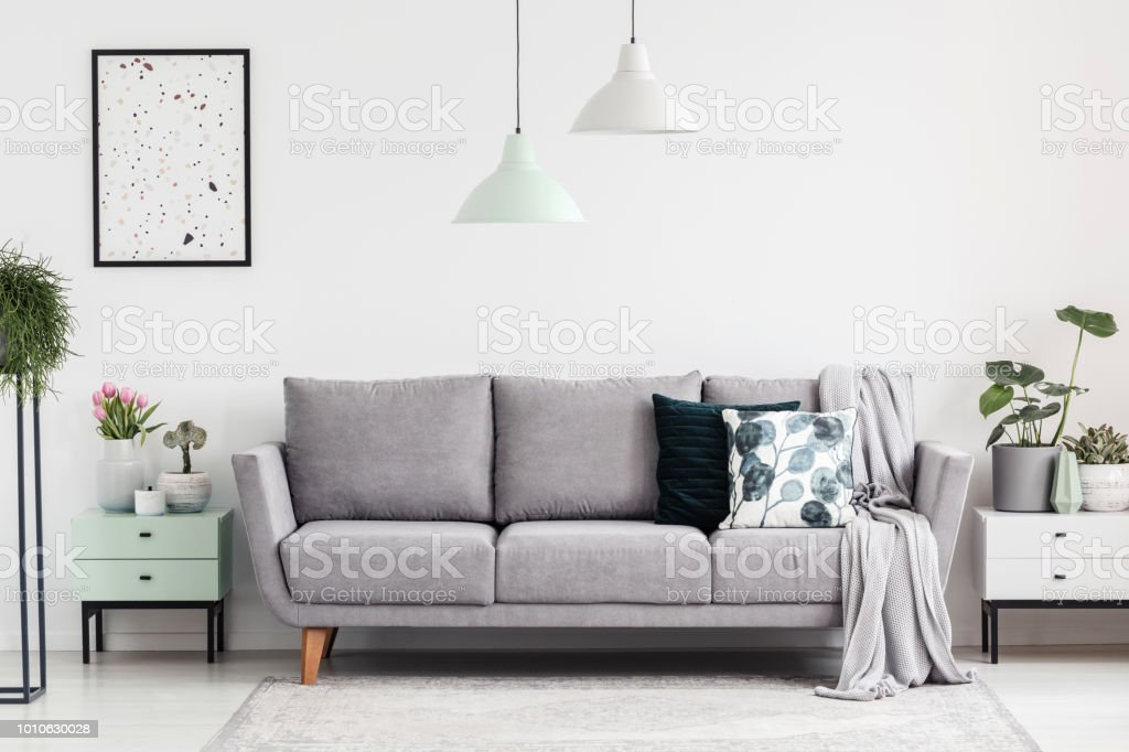 Design Bank Wit.Grey Sofa Between Cabinets With Plants In White Living Room