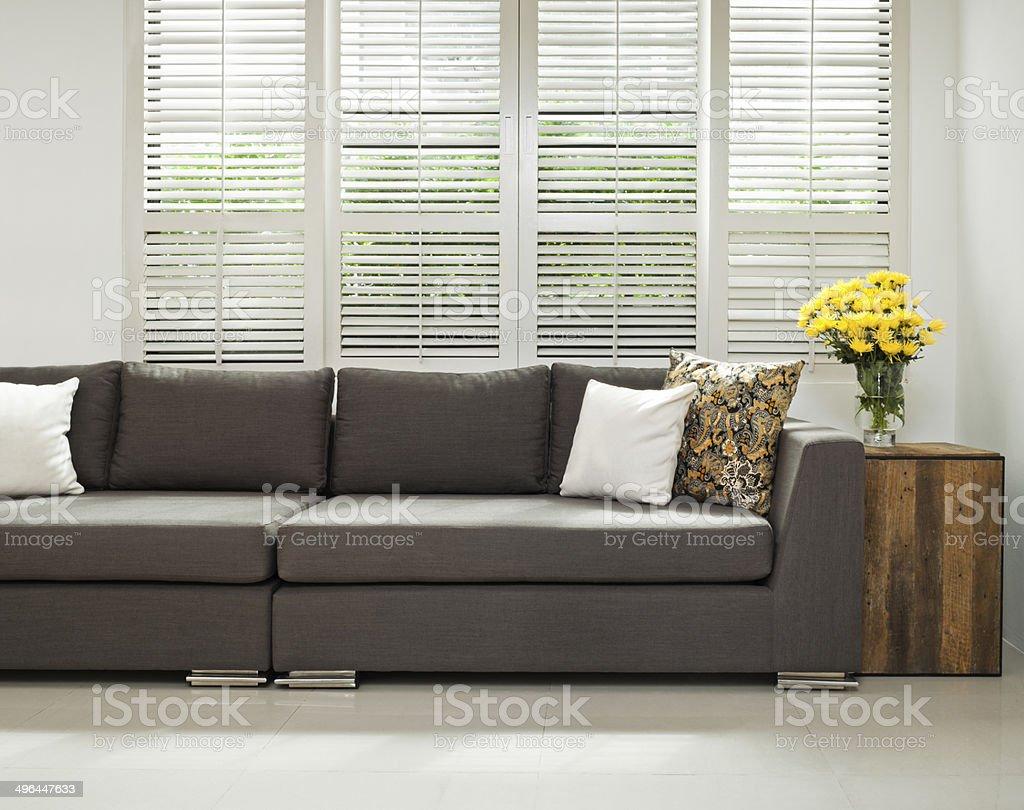 Grey sofa in simple setting stock photo
